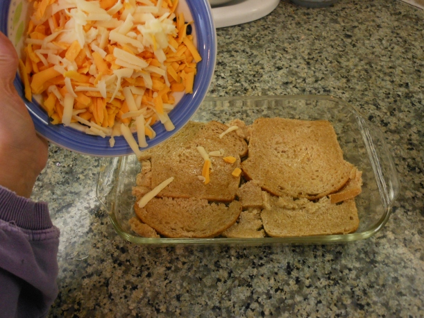 Spread cheese over buttered bread.  I used about 1/3 swiss cheese and about 2/3 sharp cheddar, because that's what I had in my fridge.