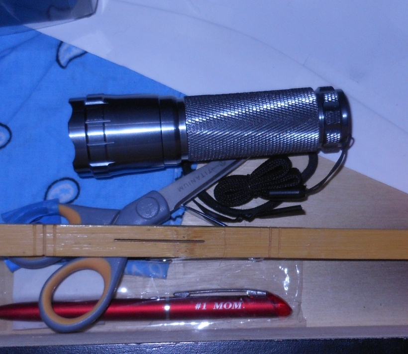 Flashlight in my nightstand.