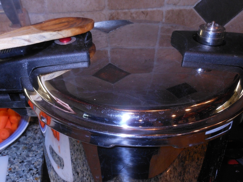 Once the timer went off, I used the pressure release valve to release the pressure within the cooker.  This allowed me to safely open it and add the veggies.
