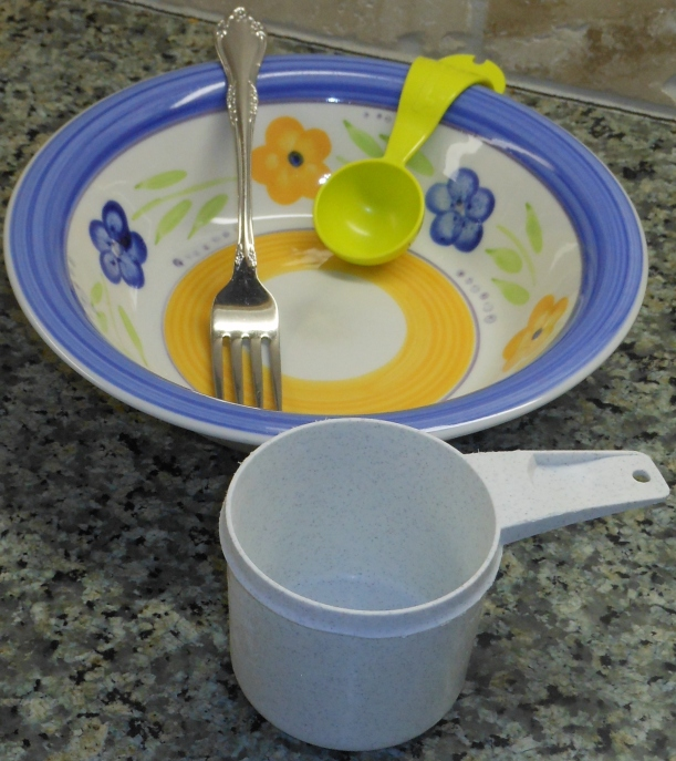 Get your tools ready: a bowl, a 1-cup measuring cup, a tablespoon measuring spoon, and a fork.  This is pretty low tech.  You may use a blender, mixer or food processor, but I think you get better results with a fork.  And there are less dishes, always a plus for me.