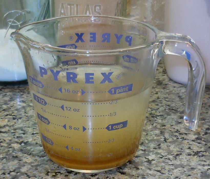 I started with the yeast.  First I put 1 1/2 cups of warm water in my handy, dandy Pyrex glass measuring cup.  Then, I added 2 tablespoons of brown sugar.  Next, I added the yeast, and let it sit.