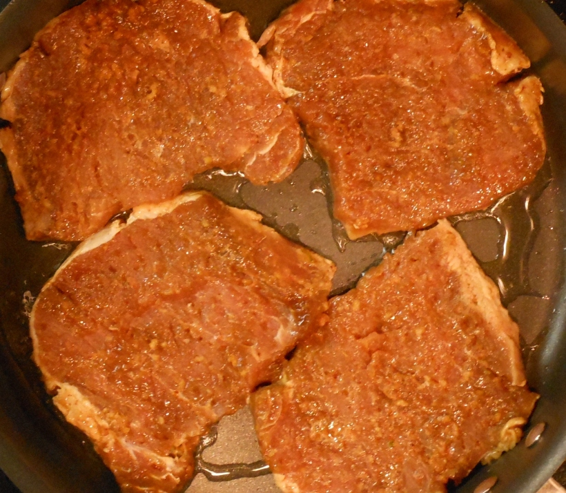 Next, I put oil into a frying pan and turned the heat on high.  In went the chops.