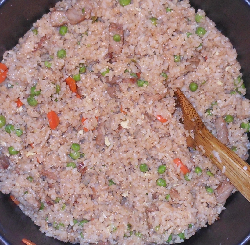 Next, add the rice to the meat/veggie mixture.  Stir gently to combine.  Add more soy sauce, salt, and pepper, to taste.