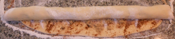 See?  I roll a little on one side, then the middle, then the other side, and it looks like this.  I stopped here, because I prefer to have the end of the dough on top when I cut, but that's a personal preference thing.  You can have the edge up or down.  It doesn't matter.