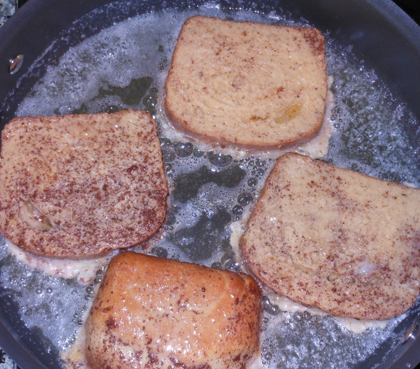 Melt butter in a pan over medium-high heat, then add bread soaked in egg mixture.  Let cook for about 2 minutes per side, or until cooked through.