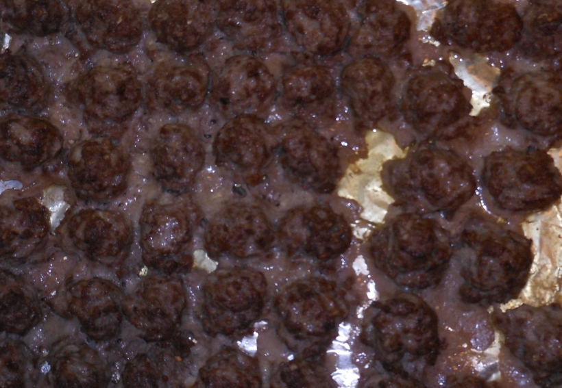 Here are the meatballs after cooking.  I take care to leave the grease and cooked meat juices on the pan and use only the meatballs by removing them one by one with tongs.