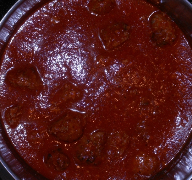 I added the meatballs to the sauce, and let them stew for at least 10 minutes.  The longer you let them simmer together, the better, so if you have an hour or so, let them stew so the flavors combine.