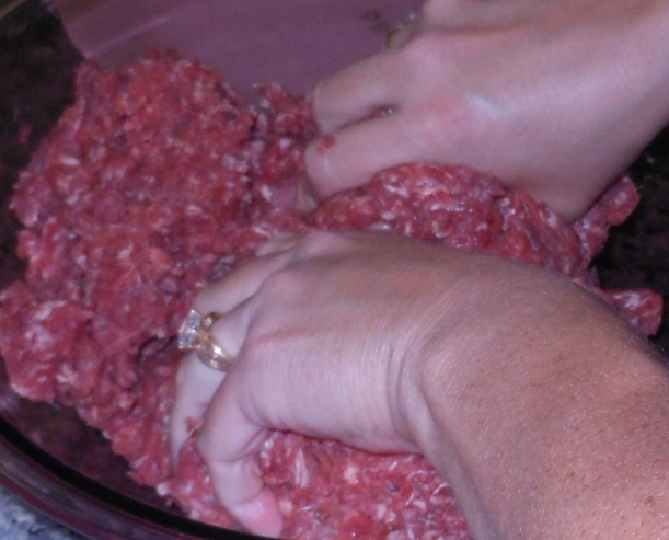 I find that mixing the meat by hand better distributes the seasoning throughout the meat.