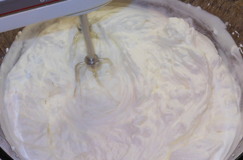 "After another minute or so, the whipped cream was getting really thick.  You can tell it's ready when you lift the beaters or whisk out of the cream and the ""peaks"" hold their shape."