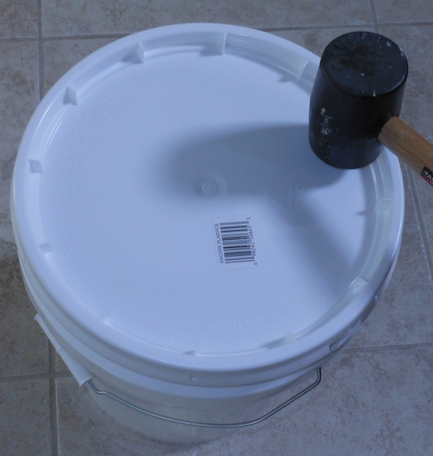 Using a rubber mallet, I put the lid on my bucket.