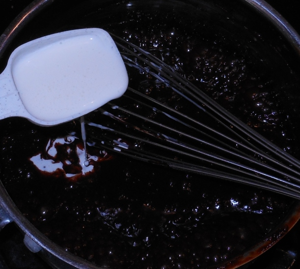 I turned the heat back on to medium high.  When the syrup started the simmer, I gradually added 3 tablespoons of heavy whipping cream, stirring with a whisk until it was incorporated.