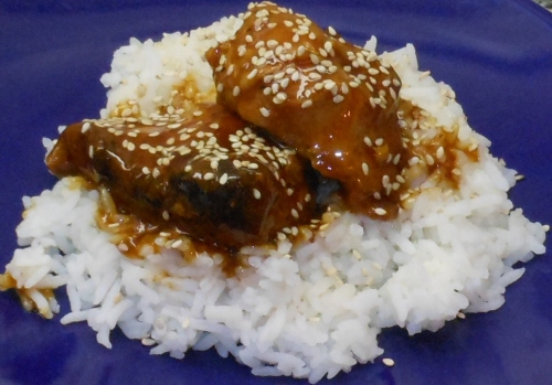 Honey Sesame Chicken over Jasmine Rice and sprinkled sesame seeds.