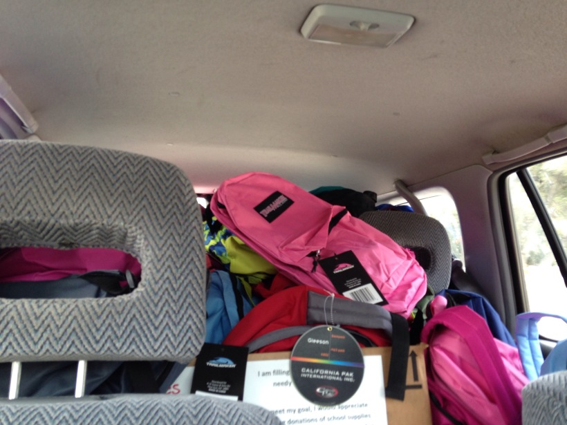 The back of my car was filled to the brim with backpacks!